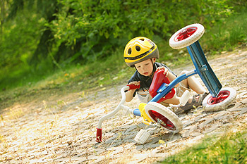 Child falling off tricycle